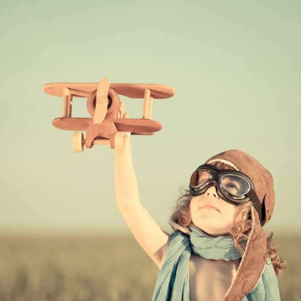 kid-with-airplane-1-600x600